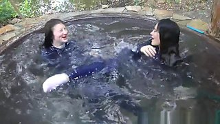 Anna and Eva take bath in a pool and in a jacuzzi in tight blue jeans