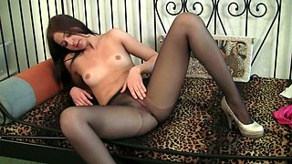 Likable hottie with pale tits spreads legs in her nylon stockings to go solo