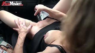 Perverted girlfriend is fucking herself with black toy in the car