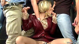 Cute blonde covered in cum after a great gangbang session