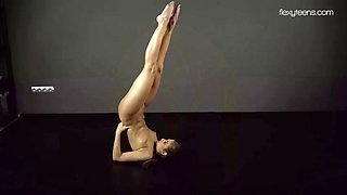 pretty and flexy girl zina nehuschova uses a clothes hanger as a pole