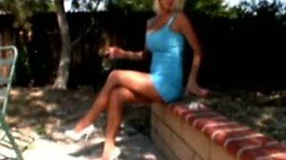 Crossed legs smoking girl