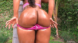 Oiled up round ebony ass of Mariah Kakes bounces on a hard big dick