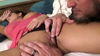 Sleeping brunette MILF gets her panties removed and pussy licked