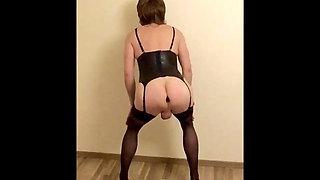 Crossdresser Katja in black lingerie shows her plugged ass
