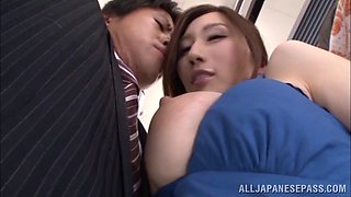 Pervy big tit Japanese woman sucks a guy's dick on a public train