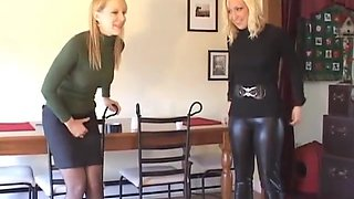 Two girls holding pee competition