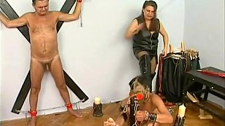 Mistress waxes extreme whipped back of slave