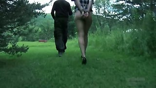 Nasty blonde gets punished by a master in the garden