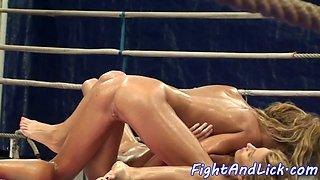Oiledup lesbo babes wrestling in boxing ring