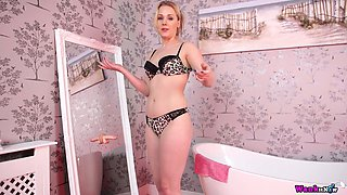 Slutty chick Aston Wilde is playing with her dildo fellow in the bathroom