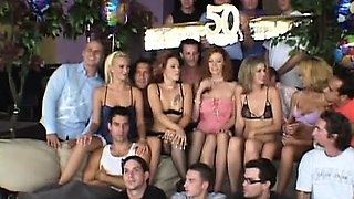 Large party watches as a wife is nailed in a threesome with a facial
