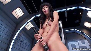 Asian spinner fucks machine to orgasm