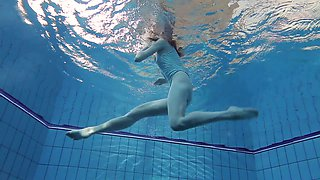Slim redhead sweetie Anna Netrebko swims naked under water