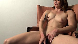 Fit Tattooed Redhead Loves Masturbating with Her Toy