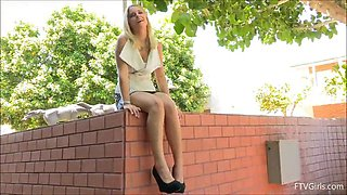 blonde slut inserts fingers in her pussy outdoors