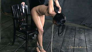 Suspended whore Nikki Darling is fucked by brutal masters
