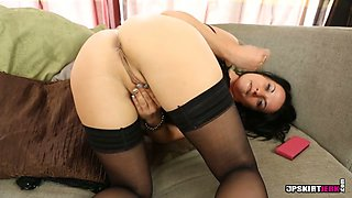 Bootyful brunette sex doll in stockings Charlie Elaine masturbates on sofa with passion