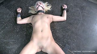 Nude blonde is punished while lying on the floor