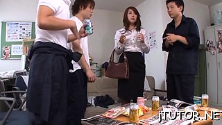 Asian teacher gets down on her knees and blows penis