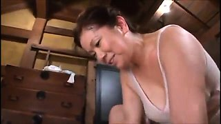 Mature Asian lady seduces a young babe for a lesbian romance