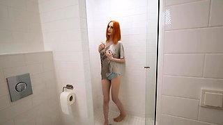 Redhead with a perfect tight body fucked in the shower