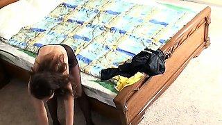 Lovely brunette amateur voyeur Veranika topless in bedroom