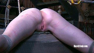 Restrained sex slave is punished in the dungeon