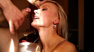 Delightful blonde cougar takes a hot cumload on her face