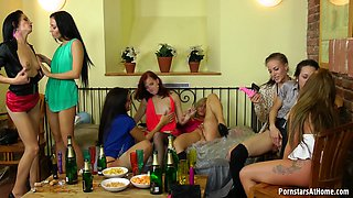 Group of mature pornstars having fun indoors with toy cocks while drinking.