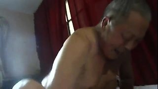 Slutty Japanese granny has a group of guys banging her pussy