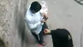 Arab whore wife cheats her husband in the street. Hidden cam