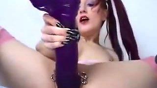 Pierced Gothic girl and her huge dildo