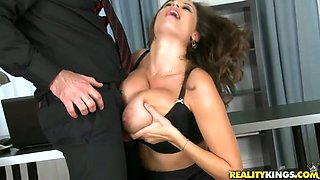 Super busty secretary gives splendid titjob to clothed boss