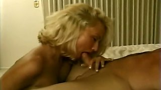 Sassy blonde horny woman sucking fat white pecker on the bed