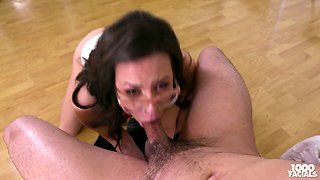 Brunette in glasses shows a blowjob master class to her sex partner