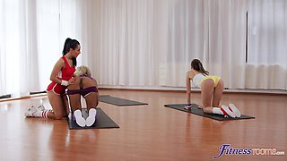 Three flexible yoga girls decide to have some fun after the session