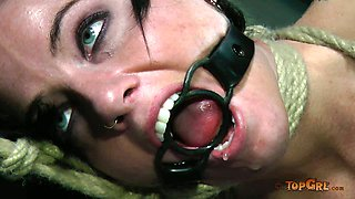 Beautiful brunette milf with big boobs is dominated in BDSM