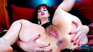 Redhead mature MILF strips on live webcam
