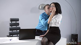 A beautiful secretary ends up fucking her boss on the floor of his office