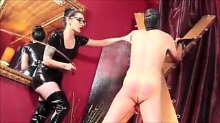 Latex Dress Mistress In Thigh High Boots Caning A Slave Hard
