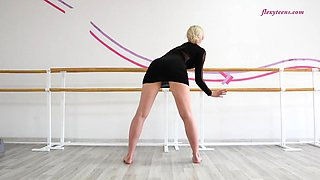 Russian blonde takes down her black clothes and stretches out the body