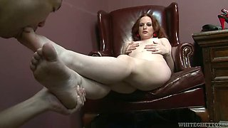 Alluring red head gets her feet licked and masturbates pussy