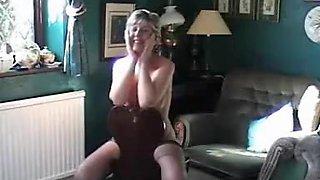 Mature slender woman hides her twat