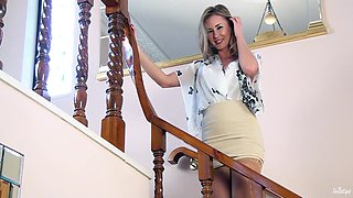 Slender model with fake tits poses in her nylons