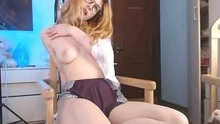 cute redhead having fun masturbating on webcam