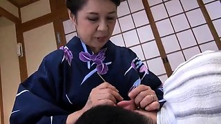 Lovely Japanese granny fucked and creampied by a young guy