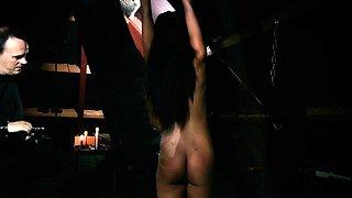 Bondage slave girl in a horror themed fetish sex scene
