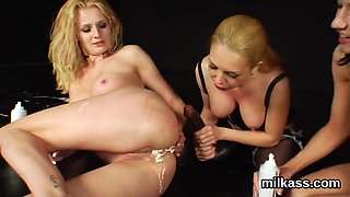 Wicked lesbians fill up their monster asses with milk and squirt it out