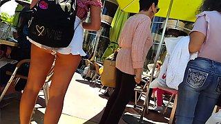 Street voyeur follows a hot brunette teen with a perfect ass